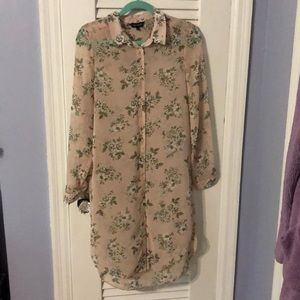 NWOT. Long-sleeved, see-through floral tunic.